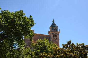 Church on a hill. Church among green plants. The church is sunny in the summer rays. An interesting journey. Wall mural
