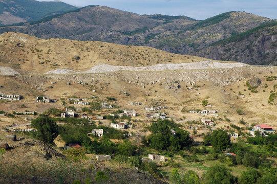 Deserted landscape with bombed houses in Nagorno Karabakh after war