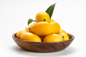 Fototapete - Side view of freshly harvested ripe Marian Plum fruit in wooden bowl on white background with clipping path.