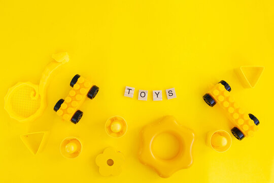 yellow childrens toys on a yellow background. mono color. stylish image