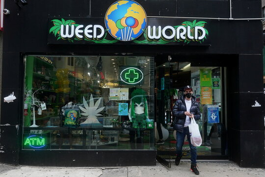 A man walks out of a Weed World store the day New York State legalized recreational marijuana use in New York City