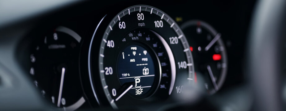 Miles Speedometer of Modern car close up. Modern car speedometer. Panoramic shot of the dashboard a car.
