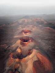 Aerial view of Timanfaya Natural Park and its amazing volcanoes and lava rivers, Lanzarote, Spain.
