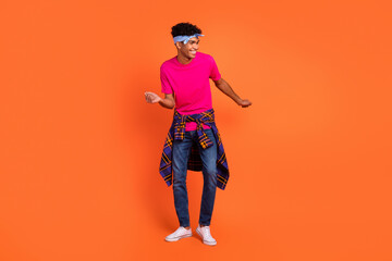 Full length body size photo of curious guy with headband dancing at party overjoyed isolated on...