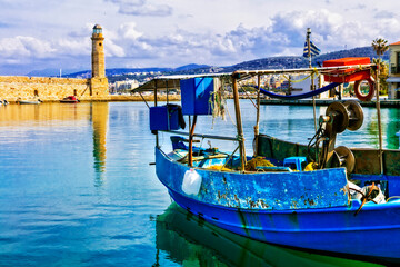 Old harbour of Rethymno town and lighthouse. Colorful fishing boats. Crete island ,Greece