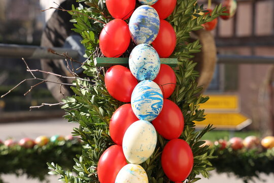 Colored decorative eggs are used to decorate wells in Germany for Easter