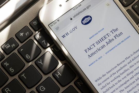 Portland, OR, USA - Apr 1, 2021: The fact sheet of the American Jobs Plan, the infrastructure plan by the Biden Administration released on March 31, 2021 is seen on the White House website on a phone.