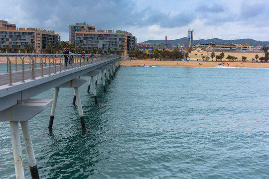 Bridge over the sea on the coast of Barcelona Mediterranean Sea