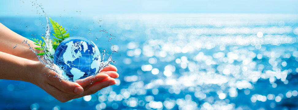 Environment Concept - Hands Holding Globe Glass In Blue Ocean With Defocused Lights