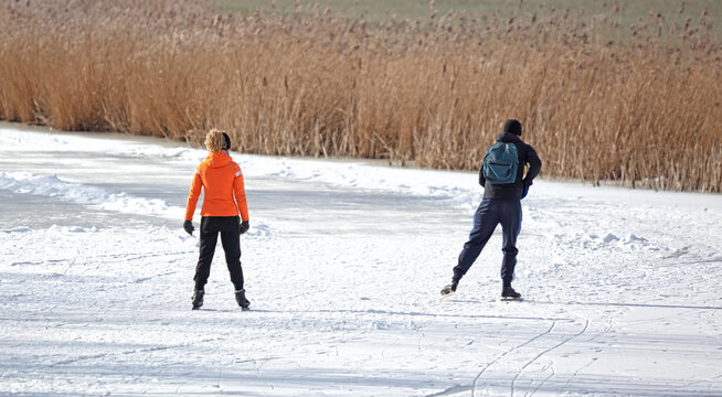 Couple skating on natural ice, Netherlands