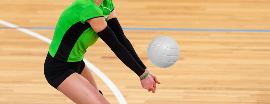 Volleyball player is a female athlete getting ready to serve the ball. Professional sport concept
