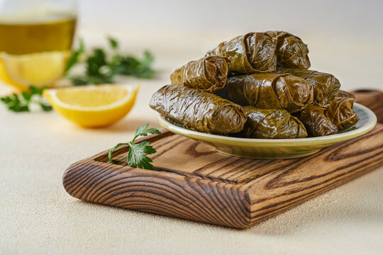 Stuffed grape leaves  rolls dolma. Traditional middetarean ,caucasian ,turkish and arabic  cuisine  . Closeup