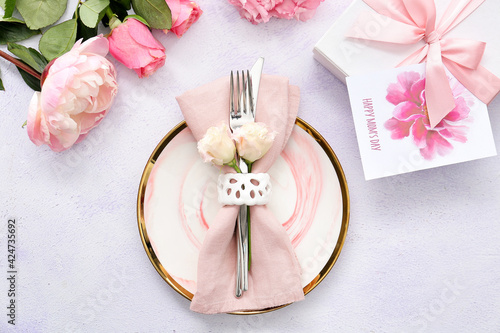 Beautiful table setting for Mother's Day on light background
