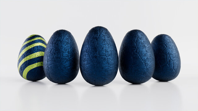 Easter Eggs isolated against a white background. Chocolate Eggs wrapped in patterned Green and Navy foil. 3D Render