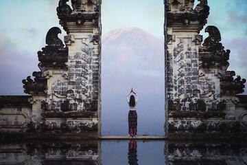 Female tourist at temple gates of heaven
