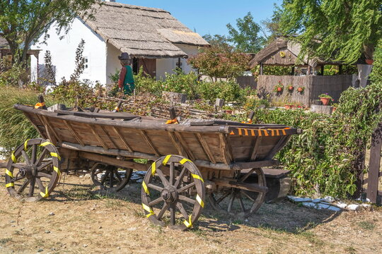 Stylized rustic Cossack courtyard with a wooden cart