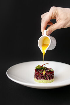 Vegetarian beetroot and vegetable tartare served with bearnaise sauce in a restaurant for lunch