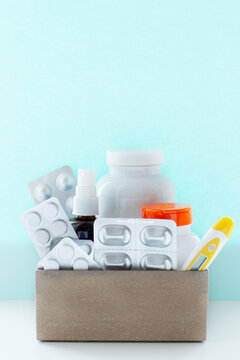 Image of a box of compounded prescription medications shipped from a mail order pharmacy on a lihgt blue background.