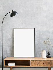 Obraz Blank picture frame mockup on gray wall. Living room design. View of modern style interior. Home staging and minimalism concept. Artwork poster showcase. - fototapety do salonu