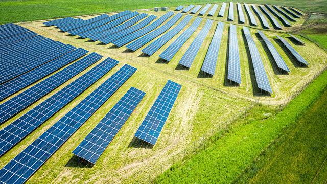 Solar panels on green field. Photovoltaic farm in Poland