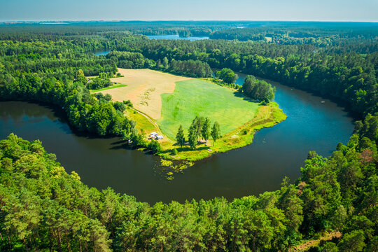 Curvy river and forests. Aerial view of wildlife in Poland
