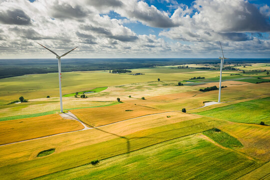 Wind turbines on field. Renewable energy in the countryside, Poland