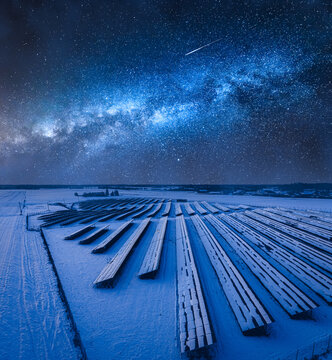 Milky way over photovoltaic farm in winter. Alternative energy, Poland.