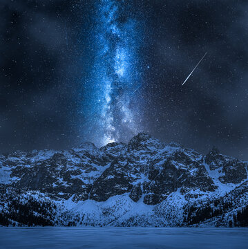 Milky way over snowy Tatra mountain. Night hiking in mountains.