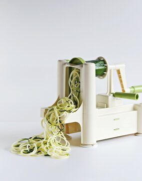 Spiralizer. Zucchini spaghetti making. Spirals, spaghetti or slices of fruit and vegetables. Selective focus