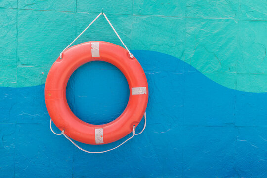 Lifebuoy hanging on a colorful wall