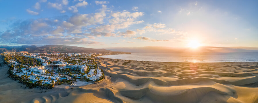 Landscape with Maspalomas town and golden sand dunes at sunrise, Gran Canaria, Canary Islands, Spain