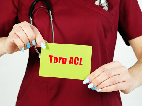 Healthcare concept about Torn ACL with phrase on the sheet.
