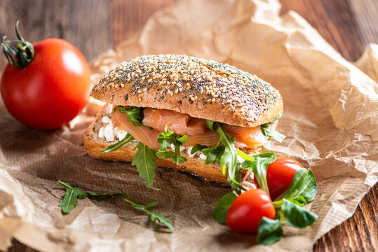 Close up of a sandwich with salmon, lettuce (arugula) and wholemeal bread