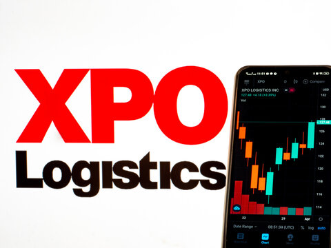 In this photo illustration the stock market information of XPO Logistics, Inc. seen displayed on a smartphone with the XPO Logistics, Inc. logo in the background.