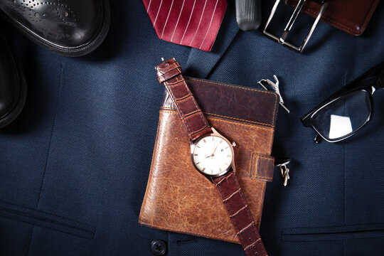 watch on wallet with accessories on suit