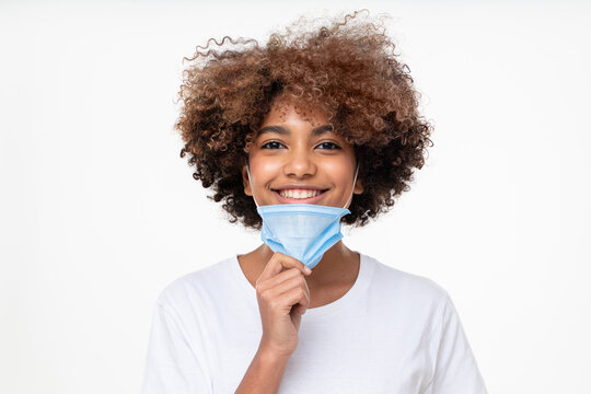 Mask off. Portrait of smiling african american school girl after end of pandemic. Covid virus defeated, people are getting back to normal life. Concept of future, hope and recovery.