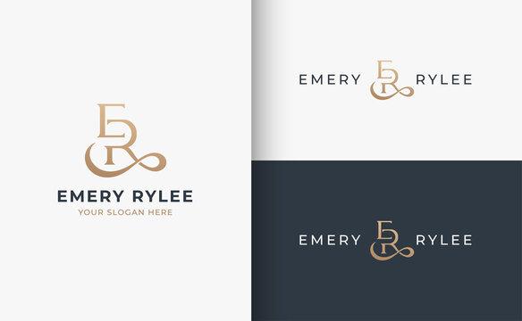 E R monogram serif letter logo design