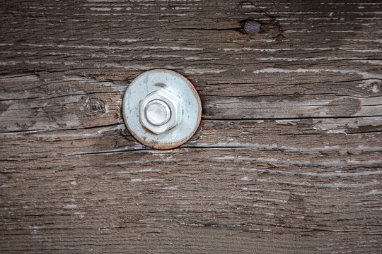 Bolt in Wooden Construction. Old Painted Wood