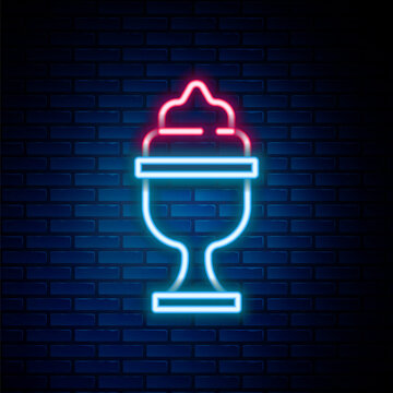 Glowing neon line Ice cream in the bowl icon isolated on brick wall background. Sweet symbol. Colorful outline concept. Vector