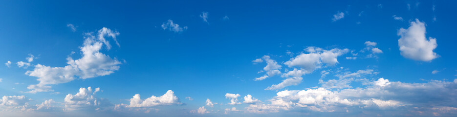 Fototapeta Panoramic fluffy cloud in the blue sky. Sky with cloud on a sunny day.
