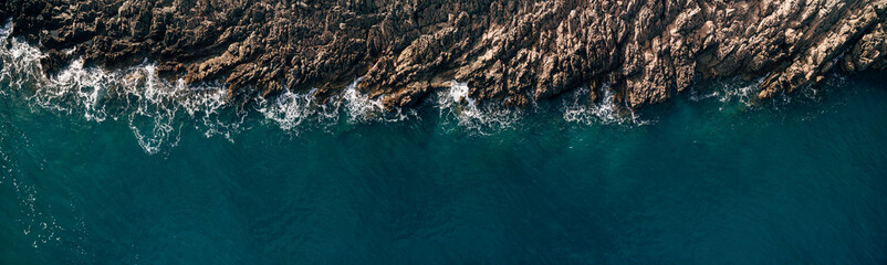 Wild Ocean water from above - Waves hitting the rocks - aerial photography