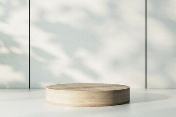 Empty wooden round podium on warm shadow surface at sunny wall backdrop. 3D rendering, mockup