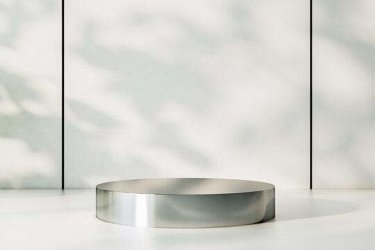 Empty metallic round stand on light shadows surface at sunny wall background. 3D rendering, mockup