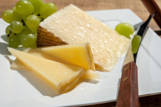 Cheese collection, piece of spanisch hard manchego cheese made in La Mancha region from sheep milk with green grapes