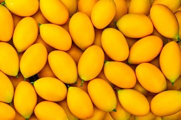 Fototapete - Yellow collection. Top view pile of the most popular ripe fruit in summer season in Thailand, marian plum, Bouea macrophylla, plum mango, gandaria.