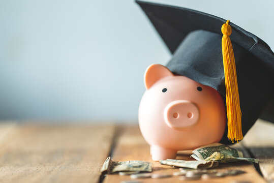piggy bank With Graduation Cap on old wood,Money saving concept.