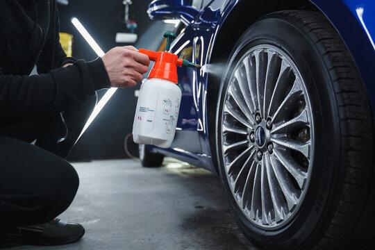 washing car wheels in garage.