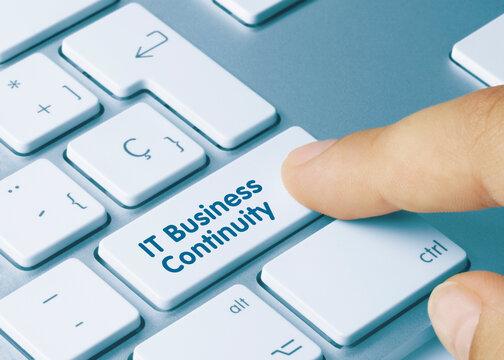 IT Business Continuity - Inscription on Blue Keyboard Key.