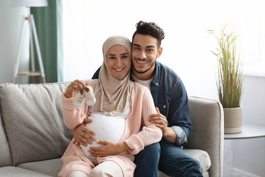 Portrait Of Happy Loving Islamic Family Awaiting For A Baby