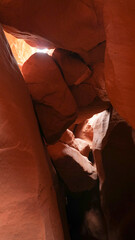 Zebra, Peek-A-Boo and Spooky Slot Canyons exploration in dry arid landscapes near Escalante Town, Utah, USA.